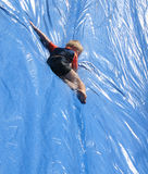 Sliding. Going down fast and having fun Royalty Free Stock Photo
