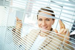 Sliding apart blinds Royalty Free Stock Image