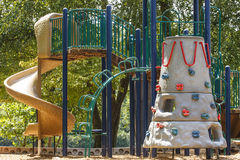 Sliding Board and Kids Climbing Wall Royalty Free Stock Photos