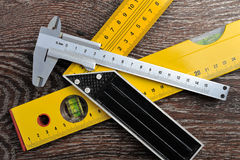 Sliding caliper, setsquare and bubble level Royalty Free Stock Photos