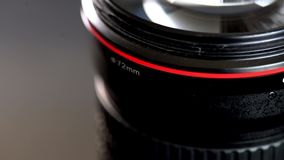 Sliding camera lens with red ring and huge frontal glass element. Sliding camera lens with red ring shot with shallow depth of field, cinematic style. Parallax stock video footage