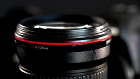 Sliding camera lens with red ring and huge frontal glass element. Sliding camera lens with red ring shot with shallow depth of field, cinematic style. Parallax stock video