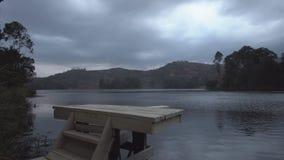 Sliding camera over bunyonyi lake springboard stock video footage