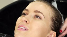Cropped sclose up of a woman getting her hair washed at the beauty salon stock image