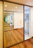 Sliding-door mirror wardrobe in modern hall interior. With infinity reflections Stock Photos