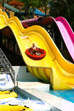Sliding down the big slide. Stock Photos