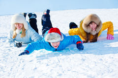 Sliding down the snowy hill Stock Photo