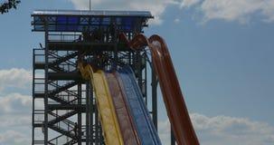 Sliding down on water slide in waterpark. Aqua park, timelapse. stock video