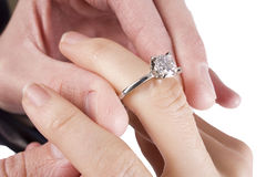 Sliding the engagement ring on royalty free stock photos