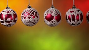 Sliding in front of beautiful crocheted christmas baubles stock video footage