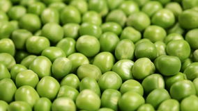Sliding in front of shelled peas layer stock video