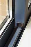 Sliding glass door detail and rail embed Stock Image