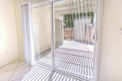 Sliding glass doors and patio area in San Diego condo Royalty Free Stock Photography