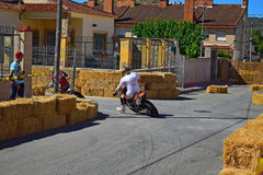 Sliding A Motorcycle. A competitor slides into the bend during the Algueña motorcycle race in Spain stock photography