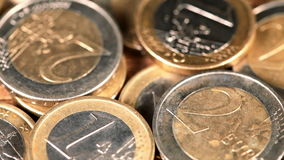 Sliding over euro coins – macro closeup stock video footage