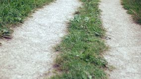 Sliding over gravel road and grass. Close up. Stabilised shot stock footage