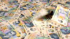 Sliding over romanian currency layer stock footage