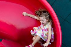 Sliding on playground Royalty Free Stock Photos