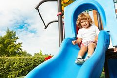 Sliding on playground Royalty Free Stock Photography