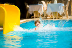Sliding in pool. Girl Sliding in pool holiday Stock Photography