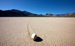 Sliding rock on dry lake bed Stock Image