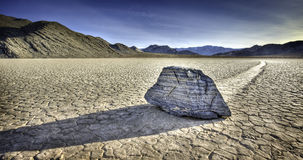 Sliding Rock at Racetrack Playa. A single sliding rock at the dry lakebed in Death Valley National Park known as racetrack playa Stock Photography