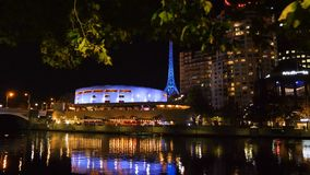 Sliding shot of The Arts Centre and Yarra river at night in downtown of Melbourne, Victoria, Australia