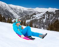 Sliding on sled from the mountain slope Stock Images