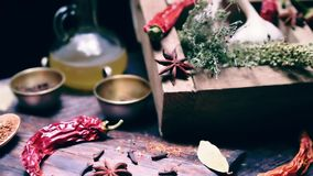 Sliding on spices and herbs cooking table stock video