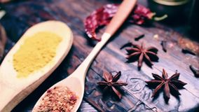 Sliding on spices and herbs cooking table stock video footage