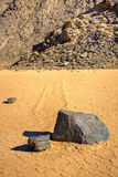 Sliding Stones On Dry Lakebed Royalty Free Stock Photography
