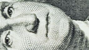 Sliding video of a one US dollar bill note, showing the portrait of US President George Washington. Macro shot. Close up stock video footage