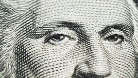 Sliding video of a one US dollar bill note, showing the portrait of US President George Washington. Macro shot. Close up stock footage