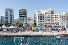Sliema Ferries. SLIEMA, MALTA - SEPTEMBER 15, 2015: Sliema skyline and ferry terminal on a sunny day on September 15, 2015 in Sliema, Malta Royalty Free Stock Photos