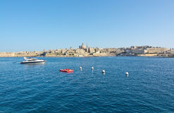Sliema Ferries. VALLETTA, MALTA - SEPTEMBER 15, 2015: Valletta skyline and ferry route from Valletta to Sliema Ferries terminal on September 15, 2015 in Valletta Stock Image