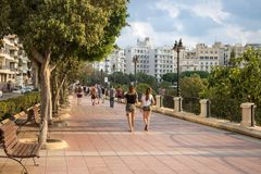 People walking on the sidewalk in Malta. royalty free stock photography