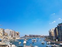 Boats in Sliema in a summer day. SLIEMA, MALTA - AUGUST 05, 2018: a port with many small boats and buildings on a summer day in Sliema, Malta Royalty Free Stock Images