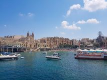 Boats in Sliema in a summer day. SLIEMA, MALTA - AUGUST 05, 2018: a port with many small boats and buildings on a summer day in Sliema, Malta Royalty Free Stock Photo