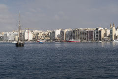 Sliema, Malta - August 03 2016: Sliema skyline and moored cruise ships. Sliema's coastline is the starting point of most ferry cruises to Gozo and Comino stock photography