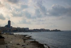 View of the sea in Malta. SLIEMA, MALTA - AUGUST 05, 2018: view from Sliema of the sea with people on the shore in a cloudy day Stock Photos