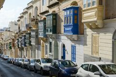 The traditional Maltese colorful wooden balconies in Sliema on M. Sliema, Malta - 2 November 2017: the traditional Maltese colorful wooden balconies in Sliema on Royalty Free Stock Photos