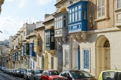 The traditional Maltese colorful wooden balconies in Sliema on M. Sliema, Malta - 2 November 2017: the traditional Maltese colorful wooden balconies in Sliema on Stock Photography