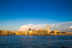 Sliema, Malta - Panoramic skyline view of Sliema at golden hour in the morning. With clouds Royalty Free Stock Photo