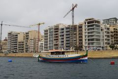 Sliema, modern port city in Malta. Sliema, port city on the island and in Malta, near capital city Valetta. Many buildings right on the coast under construction stock image