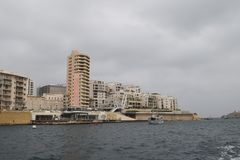 Sliema, modern port city in Malta. Sliema, port city on the island and in Malta, near capital city Valetta. Many buildings right on the coast under construction royalty free stock photos