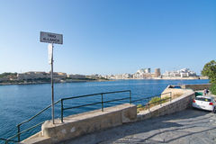 Sliema skyline and ferry. SLIEMA, MALTA - SEPTEMBER 15, 2015: Sliema skyline and ferry en route from Sliema to Valletta ferry terminal on a sunny summer day on Royalty Free Stock Images