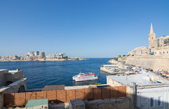 Sliema skyline and ferry. SLIEMA, MALTA - SEPTEMBER 15, 2015: Sliema skyline and ferry from Sliema to Valletta ferry terminal on a sunny summer day on September Royalty Free Stock Image