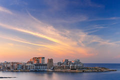 Sliema Skyline at sunset view from Valletta, Malta. Sliema, major residential and commercial area and a centre for shopping, dining, and cafe life in Malta Royalty Free Stock Image