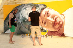 Sliema Street Art Festival. SLIEMA, MALTA - JUNE 28: Telmo Miel, muralists and imagemakers from Holland, painting at the beach during the Sliema Street Art Royalty Free Stock Photo