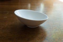 Slighly skew empty white ceramic sauceboat Royalty Free Stock Photography